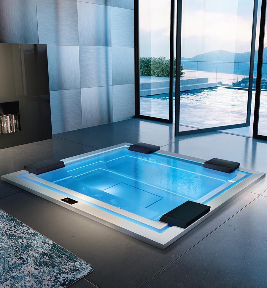 Luxusní zapuštěná vířivka pro čtyři osoby s podsvícením a čistým designem.